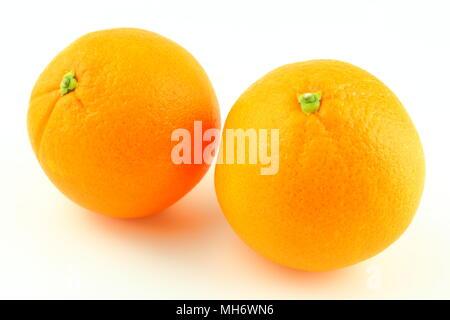 composition of fresh orange fruits isolated on a white background - Stock Photo