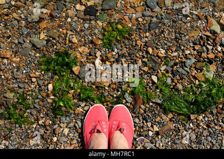 Red boots on ground top view with free copyspace - Stock Photo