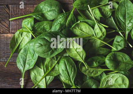 Baby spinach leaf on wood as a background. Horizontal composition. Detox, healthy lifestyle, healthy eating, vegan diet concept - Stock Photo
