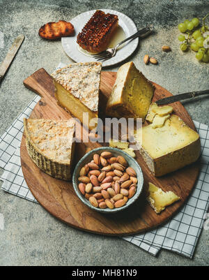 Cheese platter with cheese assortment and snacks - Stock Photo
