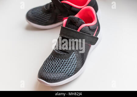 New pink, black sport shoes isolated on white background.kids running shoes. Children's running shoes. Isolated on a white background.small child sport shoes. freestyle comfort - Stock Photo