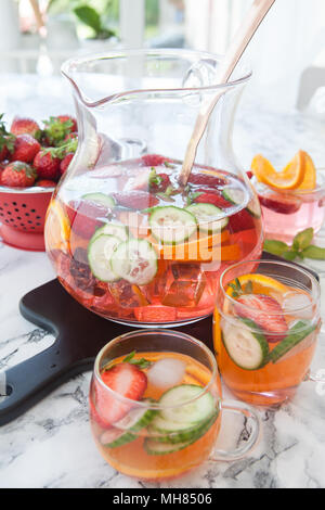 Homemade fruit punch with strawberry, orange and cucumber - Stock Photo