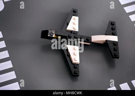 Tambov, Russian Federation - September 11, 2014 Lego custom made plane on Lego road baseplate. Studio shot. - Stock Photo