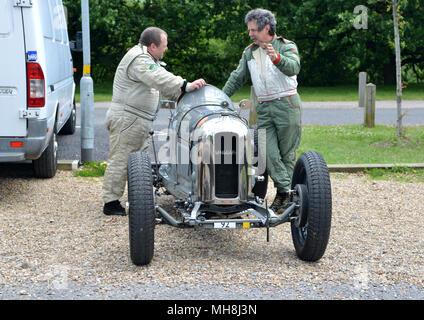 Drivers prepare aFrench pre war Amilcar racing car at Brooklands - Stock Photo