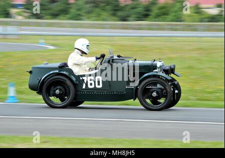 Austin Seven on track at Brooklands/Mercedes Benz World Double Twelve - Stock Photo