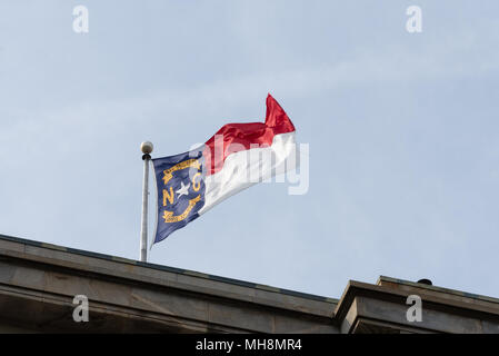 North Carolina State flag on top of the State Capitol. - Stock Photo