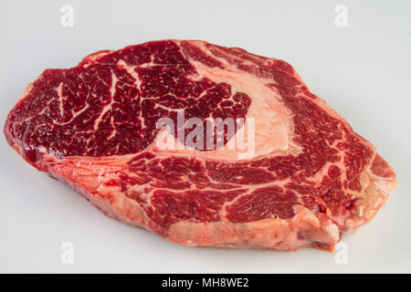 Ripened seasoned beef rib eye or entrecote steak on white background isolated - Stock Photo
