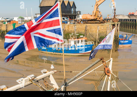 Fishing boat with a union flag and a Vote Leave flag supporting Britain's decision to vote to leave the European Union in 2016's historic vote. - Stock Photo