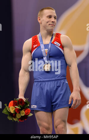 Denis Ablyazin, Russia during aqward ceremony of 5th European Championships in Artistic Gymnastics. Ablyazin won gold in vault - Stock Photo