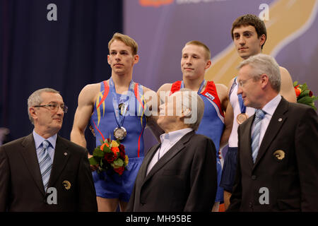 Koczi, Romania, left, Ablyazin, Russia, center, and Davtyan, Armenia during award ceremony on European Championships in Artistic Gymnastics - Stock Photo