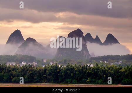 Karst mountains peaks, Yangshuo, Guangxi Province, China - Stock Photo