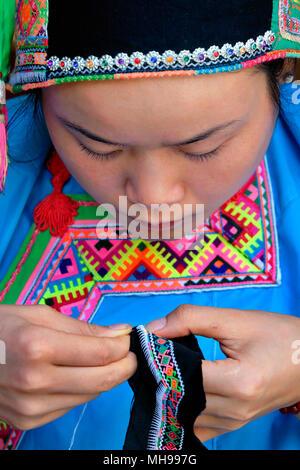 Dong minority woman wearing her national dress, Zhaoxing Village, Liping County, Guizhou Province, China - Stock Photo