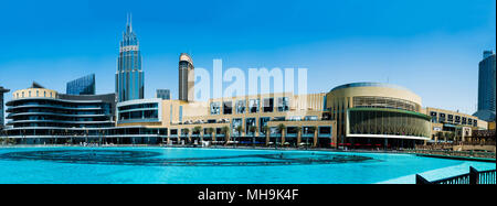 Dubai, United Arab Emirates - March 26, 2018: Dubai mall modern architecture with fountain panorama at day time - Stock Photo