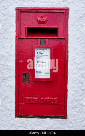 An old Royal Mail letterbox set in to a wall in the village of Kippford, Scotland. - Stock Photo