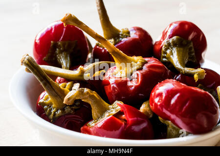 Pickled Cherry Pepper Pickles in bowl. Organic Food. - Stock Photo