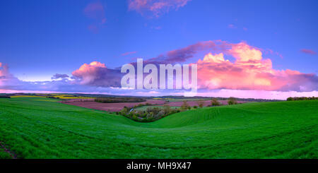 Stormy evening sunset in spring overlooking the valley of Hambledon and the South Downs from near Hoe Cross, Hampshire, UK - Stock Photo