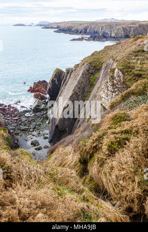 Moody coastline of Pembrokshire, Wales, seen from coast path. - Stock Photo