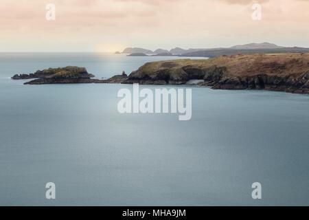 Moody light on sea and coastline of Pembrokshire, Wales, seen from coast path. - Stock Photo