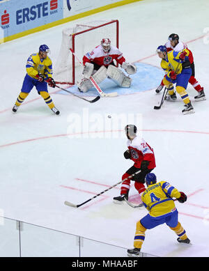 KYIV, UKRAINE - APRIL 25, 2017: Ukrainian ice-hockey players (Yellow jersey) fight for a puck with Austrian players (Red jersey) during their IIHF 201 - Stock Photo