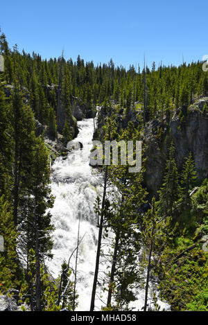 Kepler Cascades is a waterfall on the Firehole River in southwestern Yellowstone National Park. The cascades drop approximately 150 feet over multiple - Stock Photo