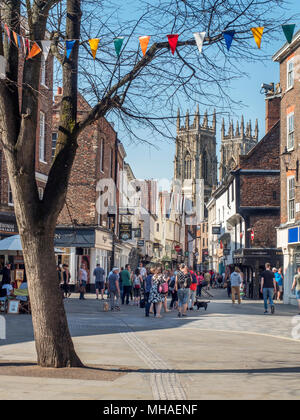 View along busy Petergate to York Minsterfrom Kings Square York Yorkshire England - Stock Photo