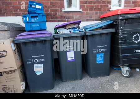 Bins piled up with rubbish in Telford shropshire . The rubbish is collected on a fortnightly basis. - Stock Photo