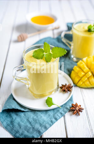 Mango Lassi - traditional Indian yoghurt drink in a glass jars - Stock Photo