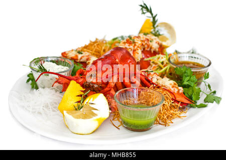 Lobster served with the vegetables on a white plate. Isolated - Stock Photo