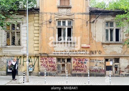 Street life in Sofia, woman on a phone, Bulgaria - Stock Photo