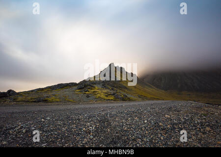 Dramatic sunset at Stokksnes and Vesturhorn in South Iceland - Stock Photo