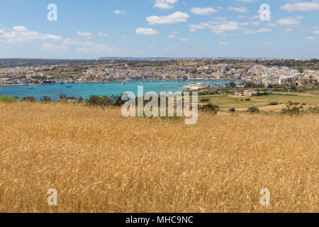 View of Marsaxlokk from hill above - Stock Photo