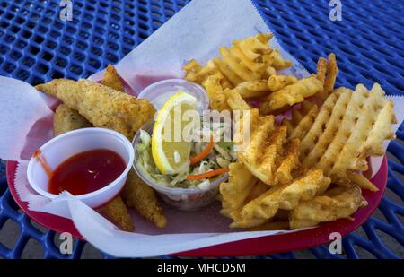 Fish and Chips Dinner Picnic Plate at Oceanside Pier Outdoors Bistro Restaurant near Pacific Ocean Coastline Southern California - Stock Photo