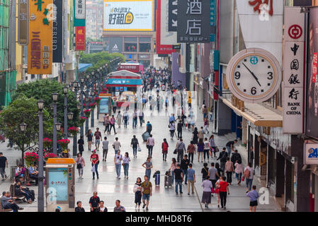 Chengdu, Sichuan Province, China - April 18, 2018: People on the famous pedestrianized shopping street Chunxi road in Chengdu, the capital of Sichuan Province in China. - Stock Photo