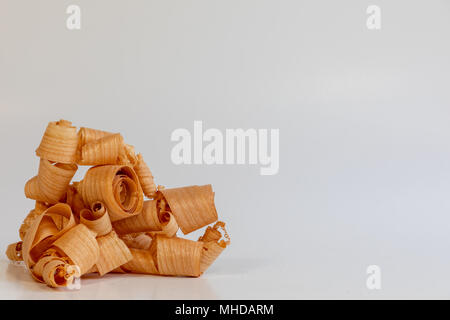 Wood shavings on white background - Stock Photo