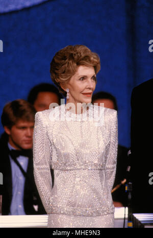 Washington, DC. USA, 20th January, 1985 First Lady Nancy Reagan listens to his husband President Ronald Reagan as he addressses the crowd at one of their Inaugural balls after he was sworn in for a second term today. Credit:Mark Reinstein /MediaPunch