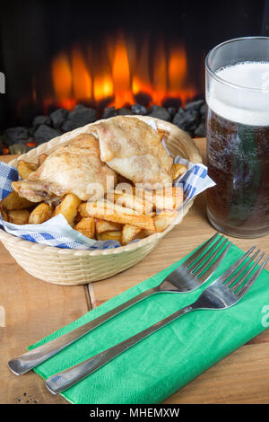 A classic English dish of Roast Chicken and chips in a basket - Stock Photo