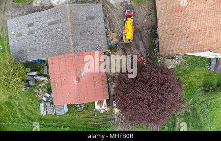 Wolfsburg, Lower Saxony, Germany, April 27, 2018: Aerial view from a vertical perspective of a construction site where liquid soil is delivered with t - Stock Photo