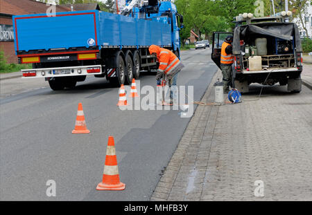 Wolfsburg, Lower Saxony, Germany, April 26, 2018: Closure of a thoroughfare to remove cores from the asphalt surface, road sampling - Stock Photo