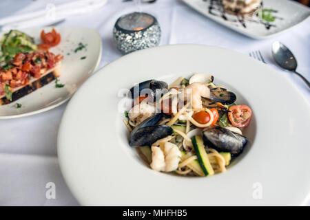 Italian Food in Restaurant - Stock Photo