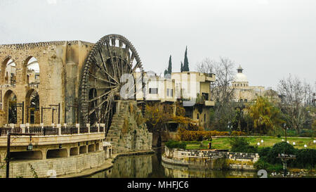 Irrigation Water-wheel norias in Hama on the Orontes river, Syria - Stock Photo