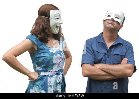 Confident woman wearing a happy face mask looks at at unconfident man who wearing a sad face mask. Real people. Copy space - Stock Photo