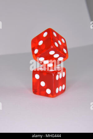 Stacked and balancing red luminescent casino gambling dice - Stock Photo
