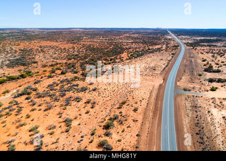 Aerial view of the great northern highway in red landscape, Eastern Goldfields, Western Australia - Stock Photo