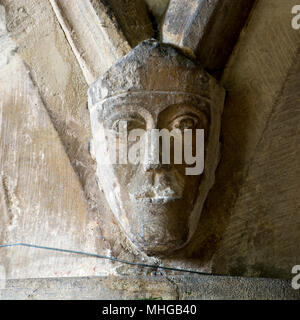 A carved head in St. Matthew`s Church, Coates, Gloucestershire, England, UK - Stock Photo