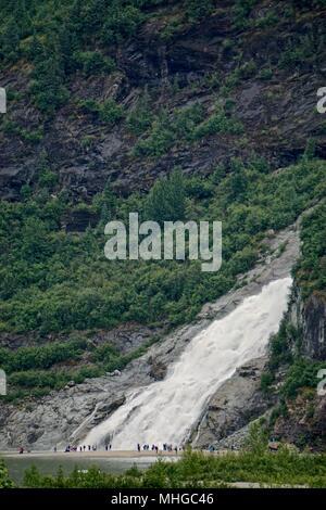 Juneau, Alaska, USA: A spectacular waterfall flows into Mendenhall Lake, near the Mendenhall Glacier. - Stock Photo