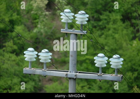 Detail view over an electric post power pole - Stock Photo