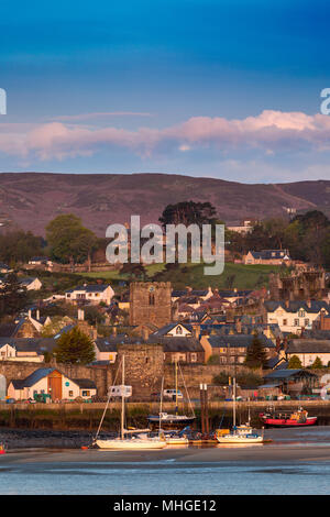 Sunrise over the harbour at Conwy in North Wales with St Mary's & All Saints Church visble close to the harbour wall, Cowny, Wales, UK - Stock Photo