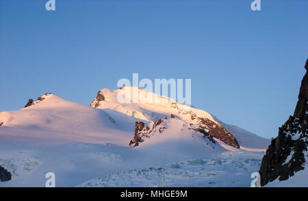 view of Strahlhorn mountain and glacier near Saas Almagell in Switzerland - Stock Photo
