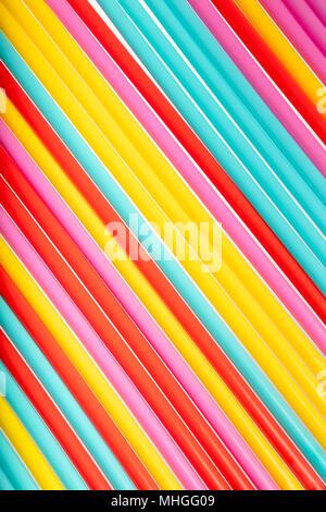 Background with bright color made from many straws, top view, summer conceptual theme, textured background - Stock Photo