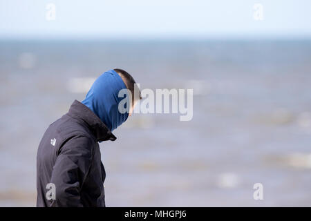 Blackpool Seafront, 1st May 2018. UK Weather.  A lovely sunny but cold & breezy day over the north west of England as visitors to the town venture out onto the famous Golden Mile promenade to take in the seaside on Blackpool seafront in Lancashire.  Credit: Cernan Elias/Alamy Live News Stock Photo